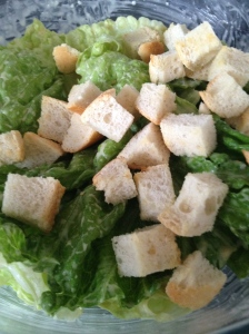 Lettuce, Caesar Dressing, Parmesan Cheese and Croutons