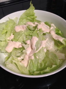 Iceberg lettuce and caesar dressing
